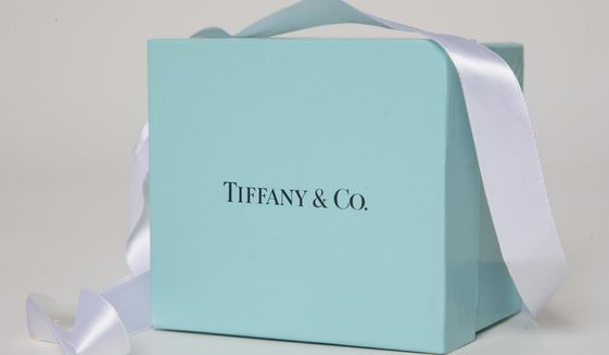 FILE - In this May 22, 2017 file photo, a gift box from Tiffany & Co. is arranged for a photo in Surfside, Fla. In a statement released Monday Oct. 28, 2019, French luxury group LVMH confirmed that it has held preliminary discussions to purchase U.S. jeweler Tiffany & Co. (AP Photo/Wilfredo Lee, File)