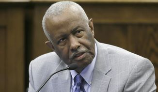 FILE - In this March 25, 2015 file photo, Rep. John Walker, D-Little Rock, speaks at the Arkansas state Capitol in Little Rock, Ark. Walker, an Arkansas lawmaker and civil rights attorney who represented black students in a long-running court fight over the desegregation of Little Rock area schools, died Monday, Oct. 28, 2019. He was 82.  (AP Photo/Danny Johnston File)