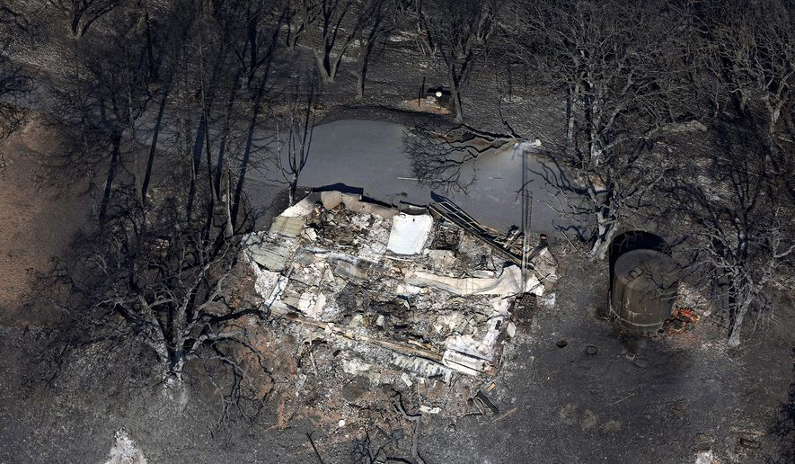 The wildfire in Northern California has destroyed dozens of structures. Millions are facing power outages too, as the utility wants to avoid sparking more wildfires. A structure lost to a wildfire called the Kincade Fire is seen in Windsor, Calif., on Tuesday, Oct. 29, 2019. (Guy Wathen/San Francisco Chronicle via AP) (ASSOCIATED PRESS)