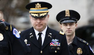 Army Lieutenant Colonel Alexander Vindman, a military officer at the National Security Council, center, arrives on Capitol Hill in Washington, Tuesday, Oct. 29, 2019, to appear before a House Committee on Foreign Affairs, Permanent Select Committee on Intelligence, and Committee on Oversight and Reform joint interview with the transcript to be part of the impeachment inquiry into President Donald Trump. (AP Photo/Manuel Balce Ceneta)