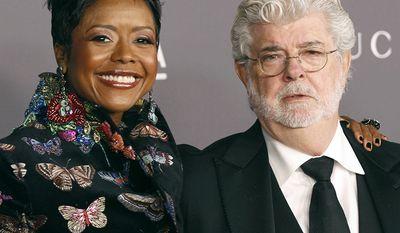 Businesswoman Mellody Hobson is married to filmmaker George Lucas. Lucas is worth $5.9 billion