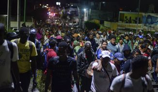 Migrants depart early in the morning from Tapachula, Chiapas state, Mexico, Saturday Oct. 12, 2019. Migrants from Africa, Cuba, Haiti, and other Central American countries set off early morning by foot from Tapachula to the southern border of the United States. (AP Photo/Isabel Mateos)