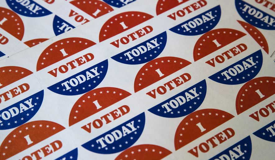 """In this May 21, 2019, file photo, """"I Voted Today"""" stickers are displayed at a polling place in Philadelphia. (AP Photo/Matt Rourke, File)"""
