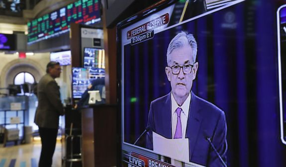 In this June 19, 2019, file photo the Washington news conference of Federal Reserve Chair Jerome Powell appears on a television screen on the trading floor of the New York Stock Exchange shows the rate decision of the Federal Reserve. The Fed concludes its two-day meeting on Wednesday, Oct. 30. (AP Photo/Richard Drew, File)