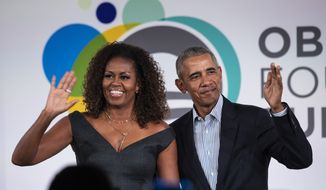 Former President Barack Obama and first lady Michelle Obama appear on stage together after the Obama Foundation Summit at the Illinois Institute of Technology in Chicago, Tuesday, Oct. 29, 2019. (Ashlee Rezin Garcia/Chicago Sun-Times via AP)