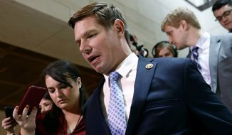 Rep. Eric Swalwell, D-Calif., walks to a secure area of the Capitol where Army Lt. Col. Alexander Vindman, a military officer at the National Security Council, arrived for a closed door meeting to testify as part of the House impeachment inquiry into President Donald Trump, Tuesday, Oct. 29, 2019, in Washington. (AP Photo/Patrick Semansky)