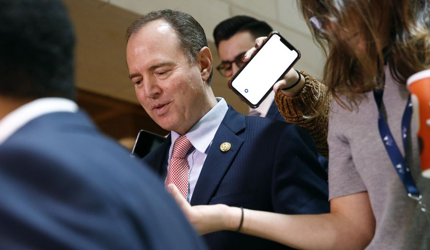 Rep. Adam Schiff, D-Calif., walks to a secure area of the Capitol where Army Lt. Col. Alexander Vindman, a military officer at the National Security Council, arrived for a closed door meeting to testify as part of the House impeachment inquiry into President Donald Trump, Tuesday, Oct. 29, 2019, on Capitol Hill in Washington. (AP Photo/Patrick Semansky)