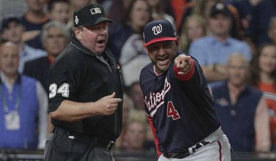 Washington Nationals manager Dave Martinez argues an interference call during the seventh inning of Game 6 of the baseball World Series against the Houston Astros Tuesday, Oct. 29, 2019, in Houston. (AP Photo/David J. Phillip) ** FILE **