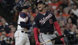 Washington Nationals' Juan Soto reacts after posing out during the first inning of Game 6 of the baseball World Series against the Houston Astros Tuesday, Oct. 29, 2019, in Houston. (AP Photo/David J. Phillip)