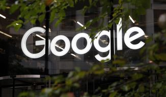 In this Nov. 1, 2018, file photo, the Google logo at their offices in Granary Square, London. (AP Photo/Alastair Grant, File)