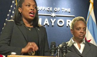 Chicago Public Schools CEO Janice Jackson, with Mayor Lori Lightfoot, discusses the state of teacher contract talks at City Hall in Chicago on Tuesday, Oct. 29, 2019. (Fran Spielman/Chicago Sun-Times via AP)