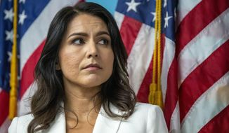 Democratic presidential candidate U.S. Rep. Tulsi Gabbard, D-Hawaii, listens as family members of victims of the terrorist attacks on 9/11 speak during a news conference at the 9/11 Tribute Museum, Tuesday, Oct. 29, 2019, in New York. (AP Photo/Mary Altaffer)