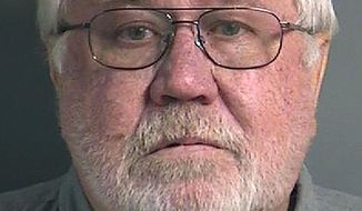 This Oct. 28, 2019, photo provided by the Johnson County Jail in Iowa City, Iowa shows Roy Browning, Jr. Browning has been charged with first-degree murder in the death of his wife, JoEllen Browning, a University of Iowa Health Care official, who was found dead in their home on April 5.  (Johnson County Jail via AP)