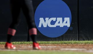 In this April 19, 2019, file photo, an athlete stands near an NCAA logo during a softball game in Beaumont, Texas. (AP Photo/Aaron M. Sprecher) ** FILE **