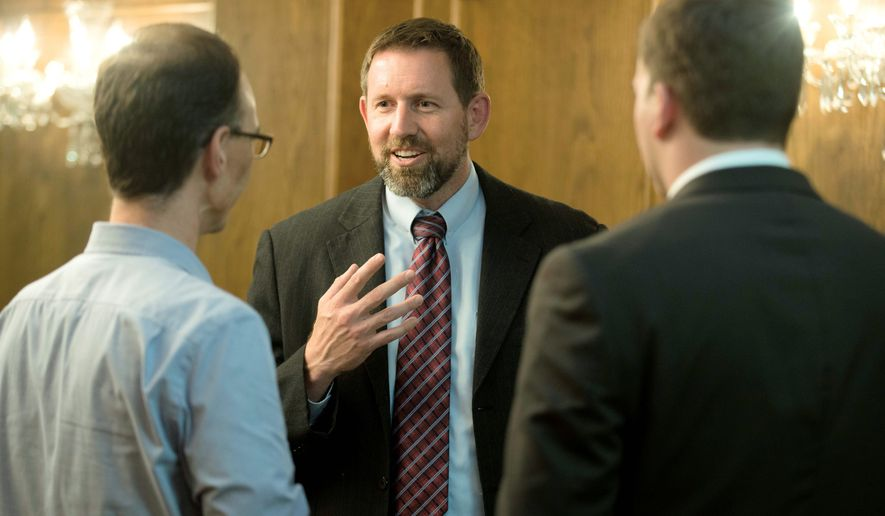 Former Montana Solicitor General Lawrence VanDyke (center) has been nominated for a position on the Circuit Court of Appeals, an effort that has been criticized by California's two senators. (Associated Press photographs)