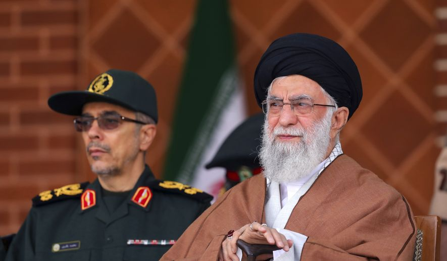 "In this picture released by an official website of the office of the Iranian supreme leader, Supreme Leader Ayatollah Ali Khamenei, right, reviews armed forces with Chief of the General Staff of the Armed Forces Gen. Mohammad Hossein Bagheri, during a graduation ceremony at Iran's Air Defense Academy, in Tehran, Iran, Wednesday, Oct. 30, 2019. Khamenei, speaking at the academy, was quoted as saying that U.S. and Western intelligence services ""are making chaos"" in the region. He urged Iraq and Lebanon to prioritize national security and respect for law while also saying the protesters' demands are ""right."" (Office of the Iranian Supreme Leader via AP)"