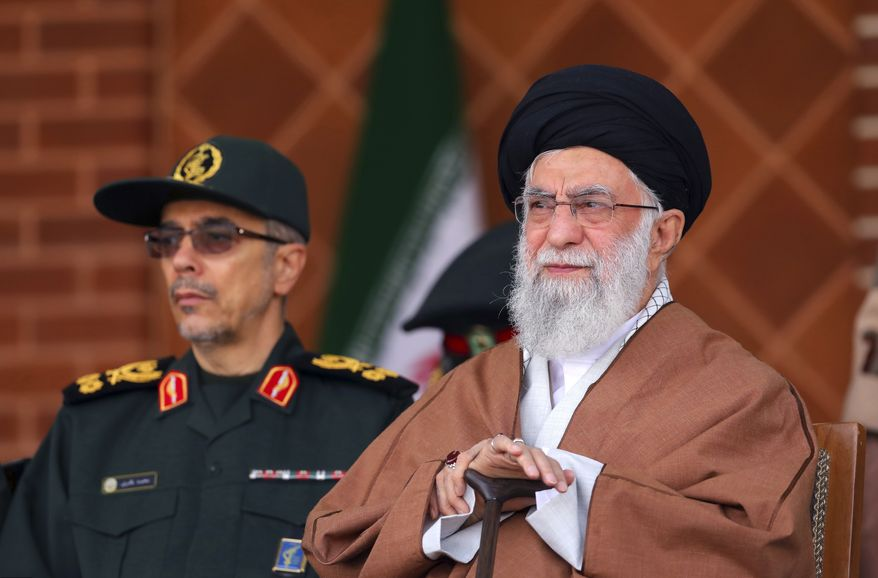 """In this picture released by an official website of the office of the Iranian supreme leader, Supreme Leader Ayatollah Ali Khamenei, right, reviews armed forces with Chief of the General Staff of the Armed Forces Gen. Mohammad Hossein Bagheri, during a graduation ceremony at Iran's Air Defense Academy, in Tehran, Iran, Wednesday, Oct. 30, 2019. Khamenei, speaking at the academy, was quoted as saying that U.S. and Western intelligence services """"are making chaos"""" in the region. He urged Iraq and Lebanon to prioritize national security and respect for law while also saying the protesters' demands are """"right."""" (Office of the Iranian Supreme Leader via AP)"""