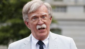 In this July 31, 2019, photo, National security adviser John Bolton speaks to media at the White House in Washington. (AP Photo/Carolyn Kaster) **FILE**
