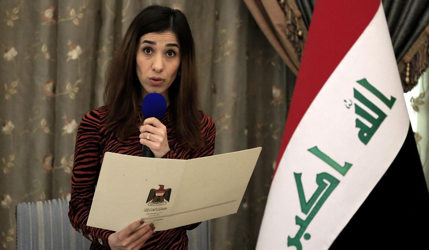 FILE - In this Dec. 12, 2018, file photo, Nobel Peace Prize recipient Nadia Murad speaks during a meeting with Iraqi President Barham Salih and other dignitaries, in Baghdad, Iraq. Murad, a Yazidi woman who was among those kidnapped and enslaved, welcomed the news of the death of Islamic State leader Abu Bakr al-Baghdadi. (AP Photo/Karim Kadim, File)