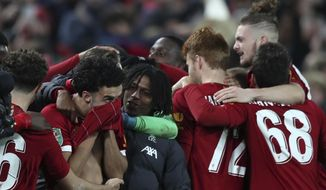 Liverpool players celebrate at the end of the English League Cup soccer match between Liverpool and Arsenal at Anfield stadium in Liverpool, England, Wednesday, Oct. 30, 2019. (AP Photo/Jon Super)