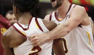 Cleveland Cavaliers' Kevin Love, right, celebrates with Collin Sexton late in the second half of the team's NBA basketball game against the Chicago Bulls, Wednesday, Oct. 30, 2019, in Cleveland. The Cavaliers won 117-111. (AP Photo/Tony Dejak)