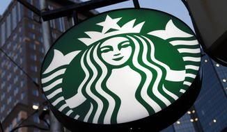 This June 26, 2019 file photo shows a Starbucks sign outside a Starbucks coffee shop in downtown Pittsburgh.  (AP Photo/Gene J. Puskar, File)