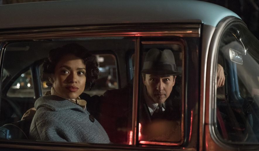 "This image released by Warner Bros. shows Gugu Mbatha-Raw, left, and Edward Norton in a scene from ""Motherless Brooklyn."" (Glen Wilson/Warner Bros. Pictures via AP)"