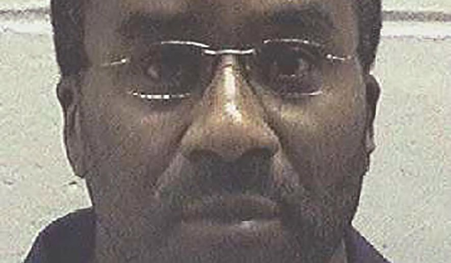 """This undated photo made available by the Georgia Department of Corrections, shows inmate Ray Jefferson Cromartie in custody. Georgia's highest court has stepped in and temporarily halted Cromartie's execution scheduled for Wednesday, Oct. 30, 2019. Cromartie was to receive a lethal injection at the state prison in Jackson for the April 1994 killing of convenience store clerk Richard Slysz in Thomasville. The Georgia Supreme Court issued a stay of execution, saying """"it appears that the pending execution order may be void.""""  (Georgia Department of Corrections via AP)"""