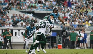 Jacksonville Jaguars tight end Josh Oliver, top right, cannot make a reception as he is hit by New York Jets strong safety Jamal Adams (33) during the first half of an NFL football game, Sunday, Oct. 27, 2019, in Jacksonville, Fla. (AP Photo/Stephen B. Morton)