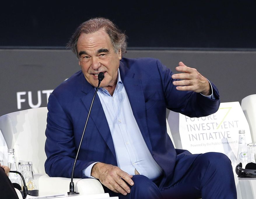 "American filmmaker Oliver Stone speaks during the Future Investment Initiative forum in Riyadh, Saudi Arabia, Wednesday, Oct. 30, 2019. Stone praised Russian President Vladimir Putin as a ""stabilizing force"" in the Middle East. Stone, who made the documentary ""The Putin Interviews,"" made the comment Wednesday during an appearance at the forum. Activists say Russian airstrikes have repeatedly targeted hospitals and civilian sites in Syria's war, something Moscow denies. (AP Photo/Amr Nabil)"