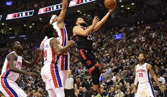 Toronto Raptors guard Fred VanVleet (23) scores over Detroit Pistons guard Bruce Brown (6) as forward Thon Maker, right, guard Langston Galloway (9) and guard Derrick Rose (25) look on during the first half of an NBA basketball game, Wednesday, Oct. 30, 2019 in Toronto. (Frank Gunn/Canadian Press via AP)