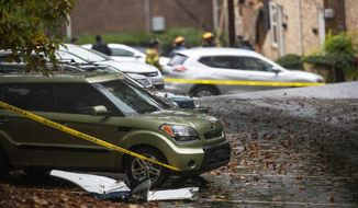 A piece of an airplane sits in a parking lot near where it crashed into an apartment complex, Wednesday, Oct. 30, 2019, in Atlanta. (AP Photo/David Goldman)
