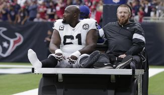 FILE - In this Oct. 27, 2019, file photo, Oakland Raiders center Rodney Hudson (61) leaves the team's NFL football game against the Houston Texans after an injury during the first half in Houston. The Raiders are preparing to make do without the anchor of their offensive line. Hudson missed practice on Wednesday with a sprained ankle that knocked him out of last week's loss at Houston and appears unlikely to be able to play this week against the Detroit Lions. Hudson is one of the most valuable members of the offense for the Raiders because of his strong blocking in the pass and run games and the ability to get the entire offense into the correct protections. (AP Photo/Michael Wyke, File)
