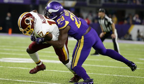Washington Redskins wide receiver Terry McLaurin (17) is tackled by Minnesota Vikings cornerback Xavier Rhodes (29) after catching a pass during the first half of an NFL football game, Thursday, Oct. 24, 2019, in Minneapolis. (AP Photo/Bruce Kluckhohn)
