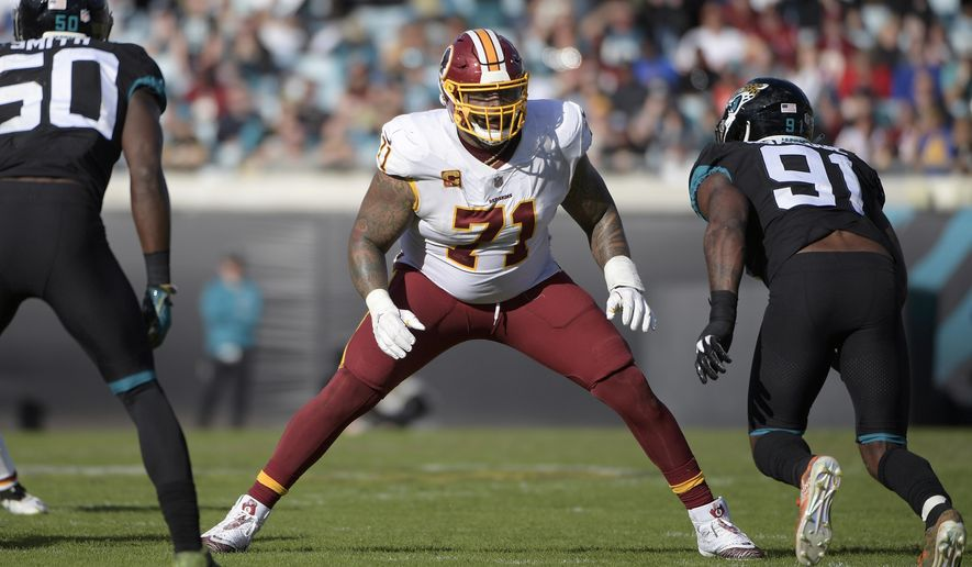 n this Dec. 16, 2018, file photo, Washington Redskins offensive tackle Trent Williams (71) sets up to block in front of Jacksonville Jaguars defensive end Yannick Ngakoue (91) during the second half of an NFL football game in Jacksonville, Fla. (AP Photo/Phelan M. Ebenhack) ** FILE **