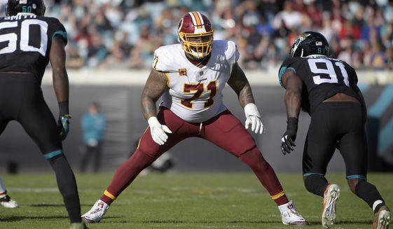 In this Dec. 16, 2018, file photo, Washington Redskins offensive tackle Trent Williams (71) sets up to block in front of Jacksonville Jaguars defensive end Yannick Ngakoue (91) during the second half of an NFL football game in Jacksonville, Fla. (AP Photo/Phelan M. Ebenhack) ** FILE **