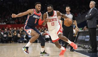 Houston Rockets guard James Harden (13) dribbles the ball against Washington Wizards guard Troy Brown Jr. (6) during the first half of an NBA basketball game, Wednesday, Oct. 30, 2019, in Washington. (AP Photo/Nick Wass)