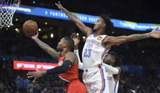 Portland Trail Blazers guard Damian Lillard, left, shoots next to Oklahoma City Thunder guard Terrance Ferguson, right, during the second half of an NBA basketball game Wednesday, Oct. 30, 2019, in Oklahoma City. (AP Photo/Kyle Phillips)