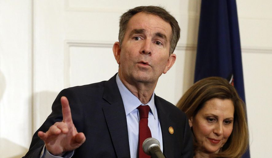 In this Feb. 2, 2019 file photo Virginia Gov. Ralph Northam, left, gestures as his wife, Pam, listens during a press conference in the Governors Mansion at the Capitol in Richmond, Va. Northam is actively campaigning for Democratic legislative candidates ahead of Election Day (AP Photo/Steve Helber, File)