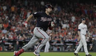 Washington Nationals' Anthony Rendon hits a double during the ninth inning of Game 6 of the baseball World Series against the Houston Astros Tuesday, Oct. 29, 2019, in Houston. (AP Photo/David J. Phillip) ** FILE **