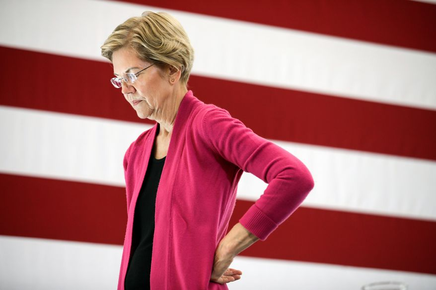 """Sen. Elizabeth Warren's plan would ban big corporations, banks and """"market-dominant"""" companies from hiring senior government officials for at least four years after they leave public office. (Associated Press)"""