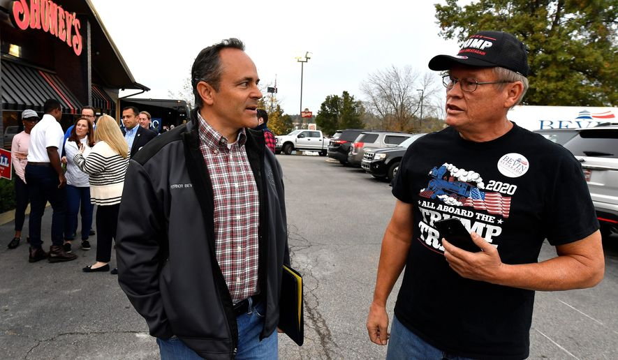 Kentucky Gov. Matt Bevin (left) accused Democratic rival state Attorney General Andy Beshear of striking a sweetheart deal for a corporate client, a drug manufacturer. The election is Tuesday. (Associated Press)