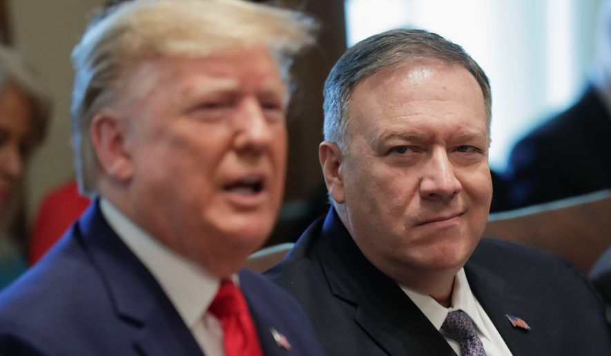 In this file photo, Secretary of State Mike Pompeo, right, listens to President Donald Trump, left, speak during a Cabinet meeting in the Cabinet Room of the White House, Monday, Oct. 21, 2019, in Washington. (AP Photo/Pablo Martinez Monsivais) **FILE**