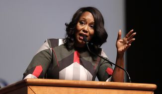 Maya Rockeymoore Cummings, widow of U.S. Rep. Elijah Cummings, speaks during a viewing service at Morgan State University, Wednesday, Oct. 23, 2019, in Baltimore. The Maryland congressman and civil rights champion died Thursday, Oct. 17, at age 68 of complications from long-standing health issues. (AP Photo/Julio Cortez)