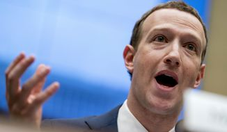 In this April 11, 2018, file photo Facebook CEO Mark Zuckerberg testifies before a House Energy and Commerce hearing on Capitol Hill in Washington. (AP Photo/Andrew Harnik, File)