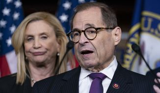 Rep. Jerrold Nadler, chairman of the House Judiciary Committee, joined at left by Rep. Carolyn Maloney, acting chair of the House Committee on Oversight and Reform, meet with reporters to discuss the next steps of the impeachment investigation of President Donald Trump, at the Capitol in Washington, Thursday, Oct. 31, 2019. (AP Photo/J. Scott Applewhite) **FILE**