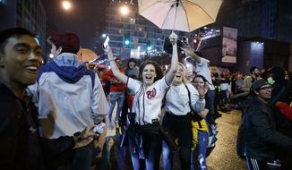 Washington Nationals fans celebrate early Thursday, Oct, 31, 2019, in Washington after the Nationals won Game 7 of the baseball World Series in Houston. (AP Photo/Alex Brandon)