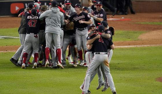 Washington Nationals celebrate after Game 7 of the baseball World Series against the Houston Astros Wednesday, Oct. 30, 2019, in Houston. The Nationals won 6-2 to win the series. (AP Photo/Eric Gay)