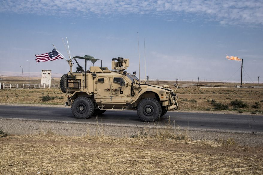 U.S. forces have been patrolling Syrian oil fields, but critics question how a continued presence there benefits national security, particularly when tensions between Washington and Moscow are escalating rapidly. (Associated Press/File)