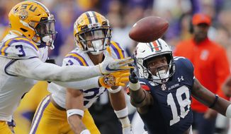LSU cornerback Derek Stingley Jr. (24) and safety JaCoby Stevens (3) break top a pass intended for Auburn wide receiver Seth Williams (18) in the second half of an NCAA college football game in Baton Rouge, La., Saturday, Oct. 26, 2019. LSU won 23-20. (AP Photo/Gerald Herbert)